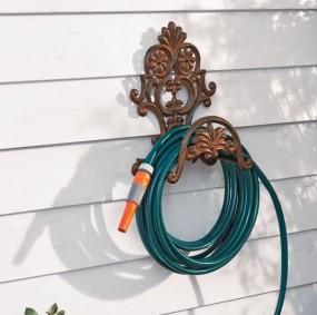Uchwyt na wąż ogrodowy z żelaza motyw kwiatowy antyk